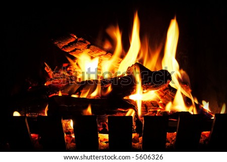 A warm, inviting open wood fire. - stock photo