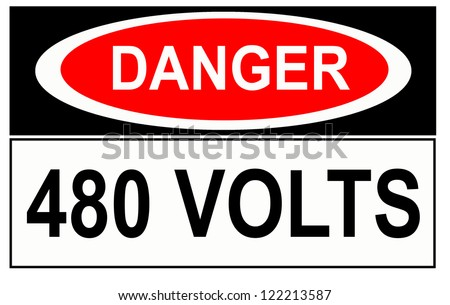 A warning sign telling people of confined space dangers - stock photo