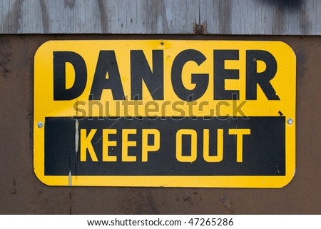 A warning sign that reads DANGER KEEP OUT. - stock photo