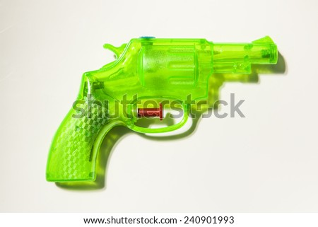 A water pistol made from green plastic on a white background - stock photo