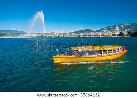A water taxi plies the pristine waters of Lake Geneva. - stock photo