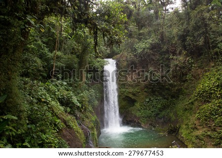 A Waterfall in Costa Rica.  Deep in the jungle it's peace and serenity  provides a place to stop and reflect and appreciate. - stock photo