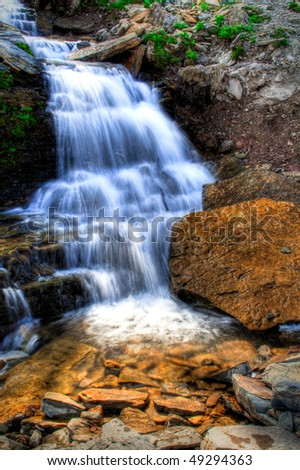 A waterfall in Glacier National Park, Montana - stock photo