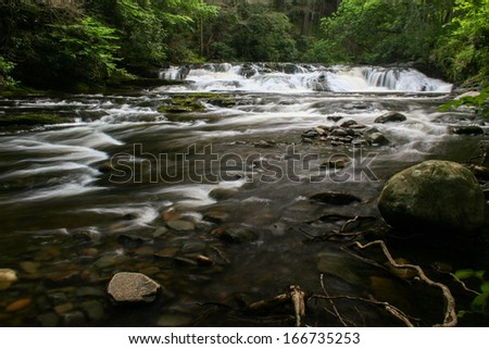 A waterfall on a small river.  Dingman's Creek, Delaware Water Gap National Recreation Area, PA, USA. - stock photo