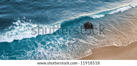 A wave breaking on a beach in central California. - stock photo