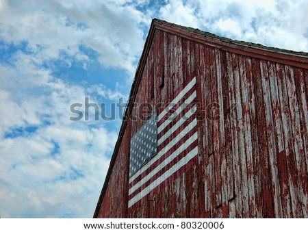 A weathered barn with an American flag. Litchfield, Connecticut. - stock photo