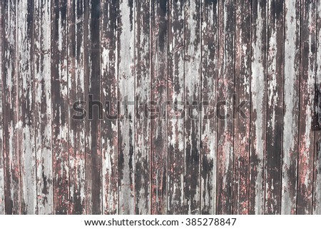 A weathered wooden surface as a background image - stock photo