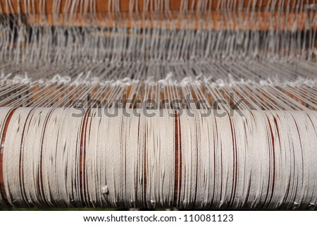 A weaving loom with the strings - stock photo