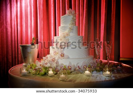 a wedding cake with a red background - stock photo