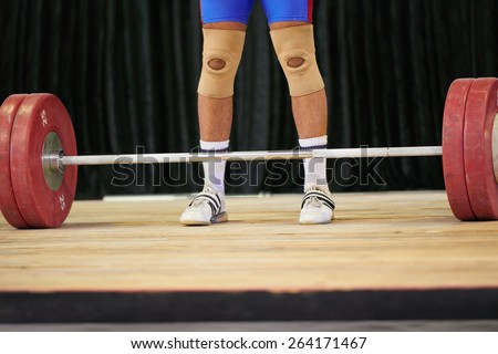 A weight lifter's feet before starting his lift - stock photo
