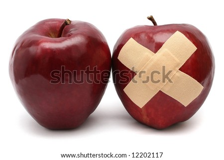 A well and good apple with a injured one. - stock photo