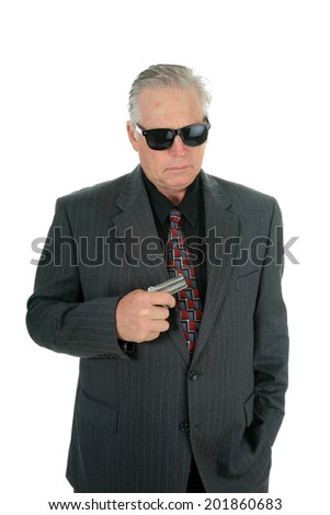 A well dress man pulls his Pocket Pistol from his vest pocket when he faces danger as a CIA Mole or Mafia King Pin or some other nefarious Character.  isolated on white with room for your text.  - stock photo
