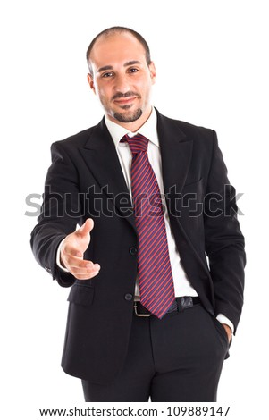 a well-dressed businessman standing on white background and greeting - stock photo