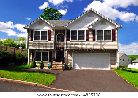 A well maintained typical colonial home on a sunny summer day - stock photo