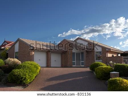 A well presented Brick Veneer house - stock photo