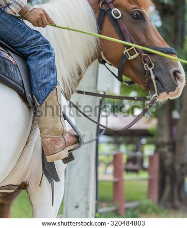 A western riding boot with spur .Side view  boot of horseman . - stock photo