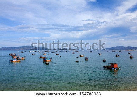 A wharf in Nha Trang beach, Vietnam. Nha Trang is well known for its beaches and scuba diving and has developed into a destination for international tourists, attracting large numbers of backpackers. - stock photo