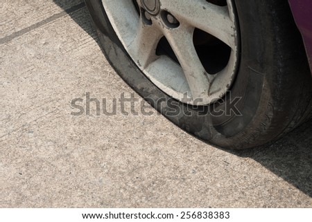 A wheel of a car tire leak because an accident. - stock photo
