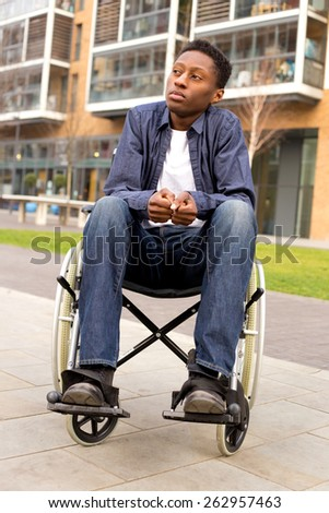 a wheelchair user feeling nervous or worried - stock photo