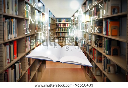 A white book is floating with sparkles and letters in a library isle. Use it for a literature or education concept. - stock photo