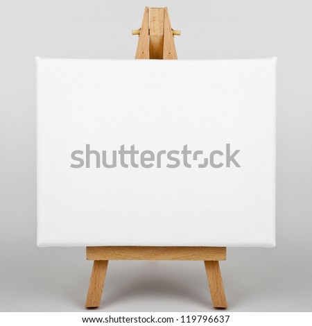A white canvas on an easel. - stock photo