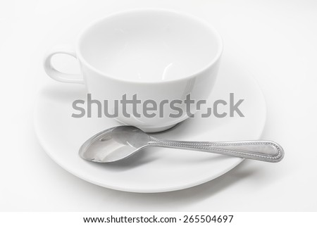 A white ceramic cup with saucer and silver teaspoon isolated on white background - stock photo