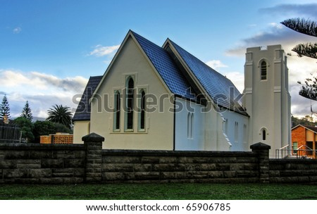 A white church against blue sky - stock photo