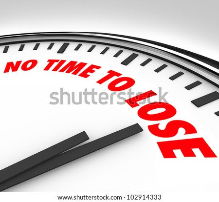A white clock with the words No Time to Lose on its face and the hands counting down the final minutes and hours until the end or deadline - stock photo