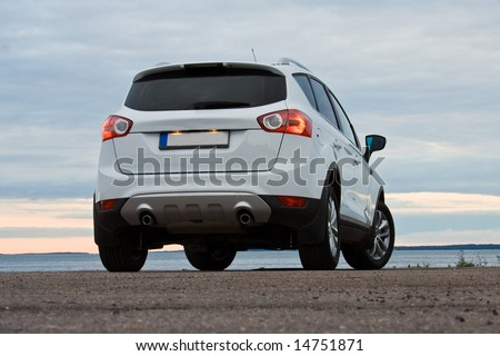 A white crossover. Dusk. Night. - stock photo