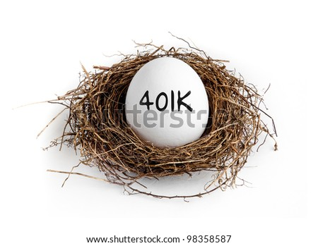 A white egg in a nest on a white background with the word 401K on the egg. - stock photo