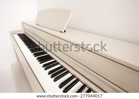 A white electronic piano(organ) close up at the daylight. - stock photo