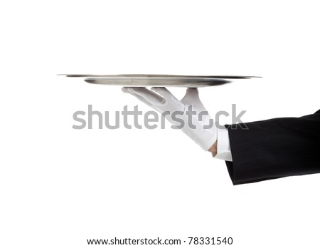 A white gloved hand holding a silver tray - stock photo