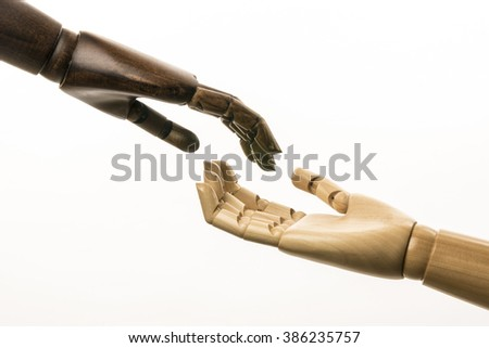A white hand and black hand begging came to his aid. On white background. - stock photo