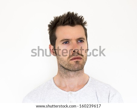 A white male staring into the distance - stock photo