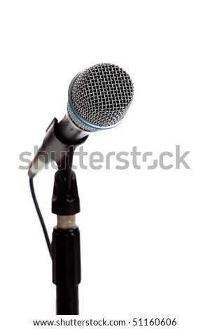 A white microphone on a white background with copy space - stock photo