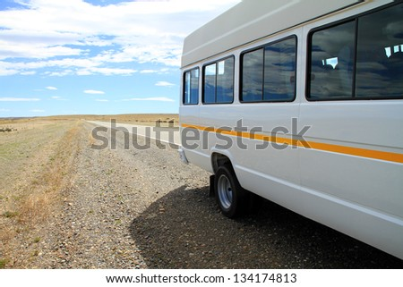 A white minibus parked on the side of the road in the rural wild area of Patagonia, South America. - stock photo