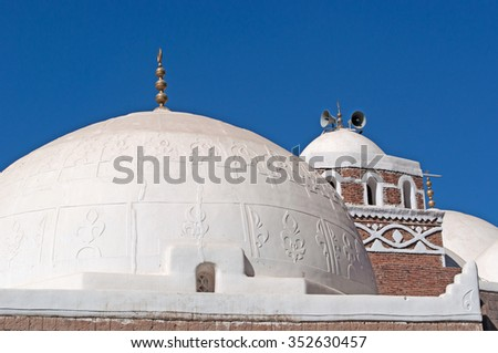 A white mosque, speakers, the crescent, the Old City of Sana'a, Republic of Yemen, Unesco world heritage site with unique architectural characteristics - stock photo