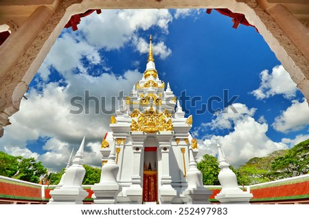 A white pagoda in frame at chiya temple , Suratthani , Thailand - stock photo