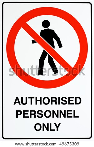 A white, red, and black authorized personnel only sign - stock photo