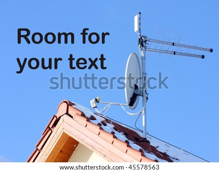 A white satellite dish and WiFi antenna on red roof - stock photo