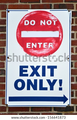 A white sign reading Do Not Enter, Exit Only - stock photo