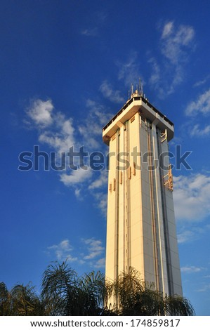 a white tower and blue sky - stock photo