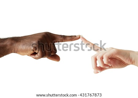 A white woman's hand and black man's hand touching with the tip of a finger. White woman and black man holding fingers together in world unity, racial love and understanding against white studio wall - stock photo