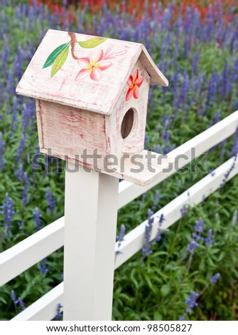 A white  wooden bird house - stock photo