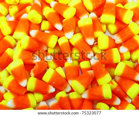 A whole bunch of candy corn for your Halloween or Thanksgiving needs with room for your text. - stock photo