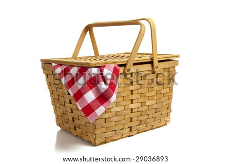 A wicker picnic basket with a red gingham cloth on a white background - stock photo