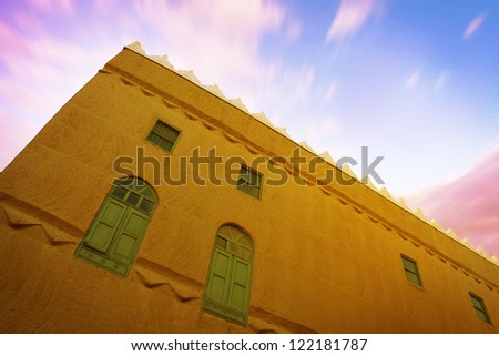 A wide angle view of an old mud house, found in Saudi Arabia. - stock photo