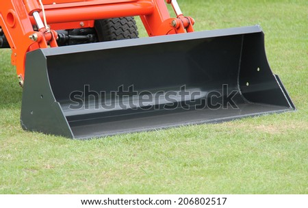 A Wide Bucket on an Orange Mechanical Excavator. - stock photo