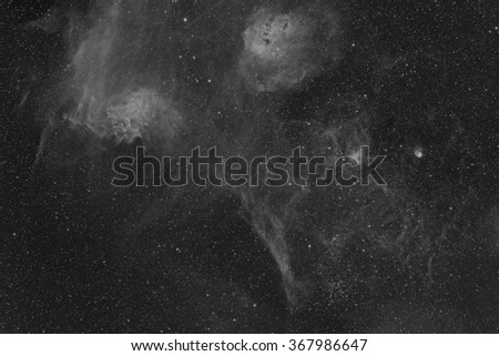 A Wide Field View in Hydrogen of the Flaming Star Nebula and several other nebulae and star clusters in the Constellation Auriga. - stock photo