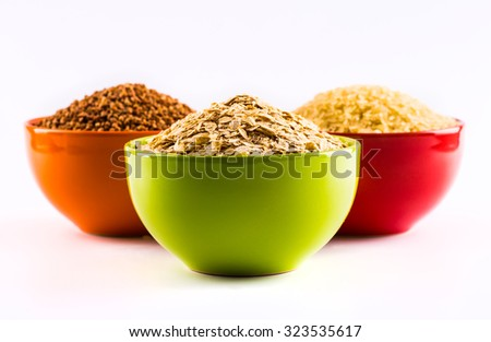 A wide range of cereals and food grains in color plates on a white background - stock photo